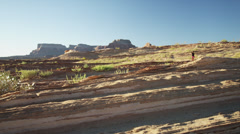 WS DS Young woman jogging in desert landscape / Lake Powell, Utah, USA Stock Footage