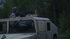Military Police Company Humvee fire their guns Stock Footage