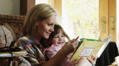 ZI CU Mother reading to daughter (4-5) / Cedar Hills, Utah, USA Stock Footage