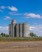 grain storage facility with silos - stock photo