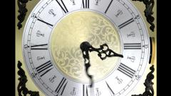 Clock face zoom running backward at speed ornate grandfather time travel Stock Footage