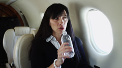 MS Woman drinking water from bottle in airplane / Spanish Fork, Utah, USA Stock Footage