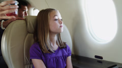 MS Girl (10-11) drinking juice in airplane / Spanish Fork, Utah, USA Stock Footage