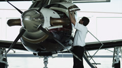 MS PAN Pilot checking private airplane in hangar / Spanish Fork, Utah, USA Stock Footage