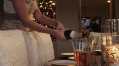 MS DS TU Woman pouring wine at dining table / Cedar Hills,Utah,USA Stock Footage