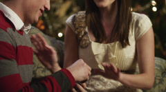 MS TD TU Young man putting engagement ring on girlfriend's finger,sitting by - stock footage