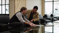 MS DS PAN Two business men sitting in office discussing project / Provo,Utah,USA Stock Footage