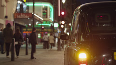 MS Couple getting out taxi / Soho, London, UK Stock Footage