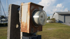 Rusty Electric Meter On Concrete Post With Clouds Moving In Background Stock Footage