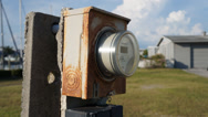 Stock Video Footage of Rusty Electric Meter On Concrete Post With Clouds Moving In Background