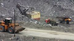 Machines excavate soil in an open pit - stock footage
