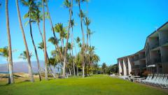 Stock Video Footage of Tropical Oceanfront Condominiums, Palm Trees