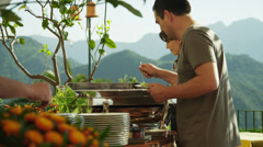 MS Couple serving food onto plates at self serve outdoor restaurant / Stock Footage