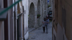 Stock Video Footage of WS HA  Young couple walking on narrow street in old town / Ravello,Italy