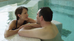 MS Couple relaxing in swimming pool / Ravello,Italy - stock footage