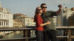 MS Couple photographing self on bridge over Grand Canal / Venice,Italy Stock Footage