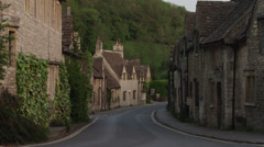 WS Village with stone houses / Castle Combe, Cotswolds, Wiltshire, UK Stock Footage