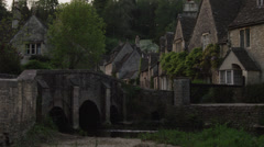 WS Stone bridge in village / Castle Combe, Cotswolds, Wiltshire, UK Stock Footage