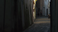 Stock Video Footage of WS Couple jogging in narrow street of narrow town at dusk / Ravello,Italy