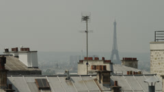 Eiffel Tower over rooftops / Montmartre, Paris, France Stock Footage