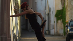 MS Woman stretching in old town alley / Ravello,Campania,Italy - stock footage