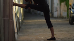 Stock Video Footage of MS TU Woman stretching in old town alley / Ravello,Campania,Italy