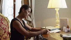 MS Woman writing letter at antique desk / Venice,Veneto,Italy Stock Footage