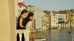 WS Couple looking at Grand Canal from balcony / Venice,Veneto,Italy Stock Footage