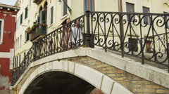 SLO MO WS TS Young couple descending steps in old town / Venice,Italy  SLO MO WS Stock Footage