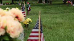 Cemetery on Memorial Day Rack Focus to Flowers Stock Footage