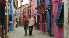 WS Couple walking on narrow street of old town / Murano,Venice,Italy Stock Footage