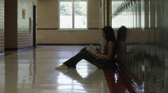 WS DS Female student reading in school corridor / Spanish Fork City, Utah, USA Stock Footage