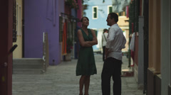 WS Couple arguing on street / Murano,Venice,Italy Stock Footage