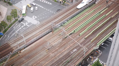Bullet train passing on elevated track, Tokyo, Japan Stock Footage