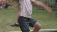 MS Girl (4-5) dancing in amusement park / American Fork City, Utah, USA Stock Footage