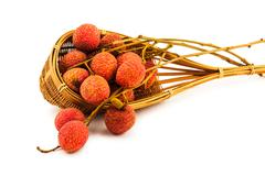 Fresh lychee in a bamboo basket Stock Photos