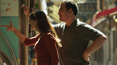 MS Couple talking to shop vendor standing on street / Venice,Veneto,Italy - stock footage