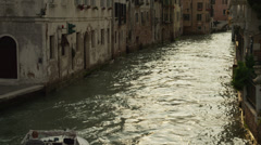 WS HA Motorboat moving along canal / Venice,Veneto,Italy Stock Footage