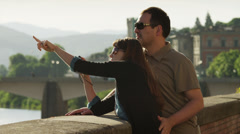 MS Couple taking photographs standing by ledge / Florence,Tuscany,Italy - stock footage