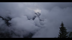 WS Clouds covering snow capped Alps / Murren, Switzerland - stock footage
