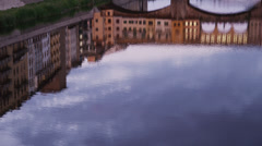MS Reflection of Ponte Vecchio in Arno river at dusk / Florence,Tuscany,Italy - stock footage
