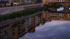 WS TU Riverfront and Ponte Vecchio at dusk / Florence,Tuscany,Italy - stock footage