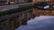 Stock Video Footage of WS TU Riverfront and Ponte Vecchio at dusk / Florence,Tuscany,Italy