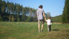 Fater and son walking Stock Footage