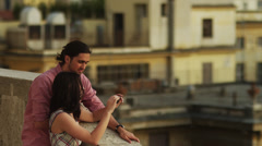 WS HA Couple taking self portrait standing by balustrade / Rome,Italy - stock footage