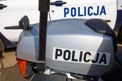 Police vehicles standing in street Stock Photos