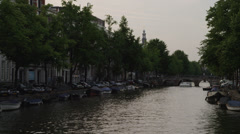 WS PAN Canal with moored boats/ Amsterdam, Netherlands Stock Footage