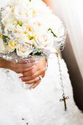Bride's bouquet and rosary details Stock Photos