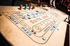 Craps table and people gambling all around Stock Photos