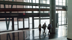 WS CS PAN Business people walking through office building's lobby / Las Stock Footage